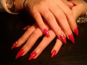 Red acrylic stiletto nails